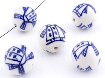 www.beadyourfashion.nl - Porseleinen kralen rond versierd met molens ± 20mm (gat ± 2mm)