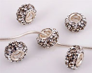Large-hole-style strass bead with 925 silver core (sterling silver) and Swarovski stones, roundel ± 7x12mm (hole ± 4mm)
