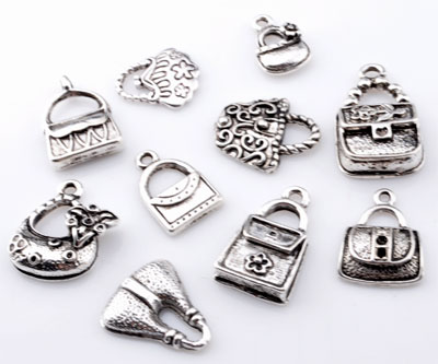 www.beadyourfashion.com - Mix metal pendants/charms bags ± 15x9mm - 24x14mm (hole ± 1,5 - 4x5mm)