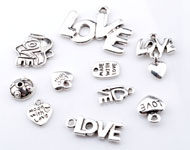 Mix metalen kralen en hangers/bedels 'love' ± 10x9mm - 30x22mm (gat ± 1-2mm)