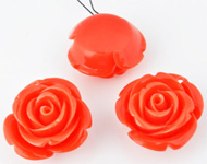 Natural stone coral (20%) with synthetic material (80%) pendant/charm rose ± 24x14mm