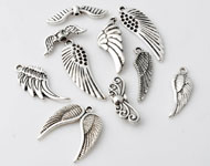 Mix metal beads and pendants/charms wings ± 22x7 - 33x10mm