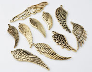 Mix metal pendants/charms wings decorated ± 35x14 - 68x18mm