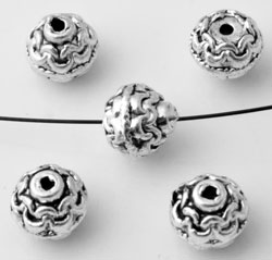 www.beadyourfashion.nl - Metalen kralen bewerkt ± 6x7mm