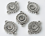 Metal pendants/connectors flower decorated ± 18x13mm with setting for SWAROVSKI ELEMENTS 2058 SS12 (± 3,1mm) flat back