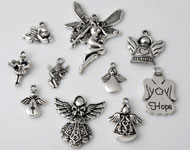 Mix metal pendants/charms angels ± 16x14 - 43x30mm