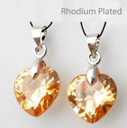www.beadyourfashion.com - Cubic zirconia pendant/charm heart faceted, with brass pendant bail rhodium plated ± 22x12mm