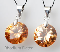 www.beadyourfashion.com - Cubic zirconia pendant/charm round faceted, with brass pendant bail rhodium plated ± 21x12mm