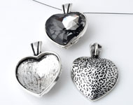 Metal pendant/charm heart decorated ± 41x30mm with setting for SWAROVSKI ELEMENTS 4827 ± 28mm Fancy Stone