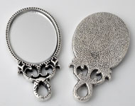 Metal pendants/charms mirror decorated ± 54x28mm