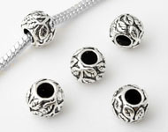 Large-hole-style 925 silver bead (sterling silver), roundel decorated with leafs ± 10x7mm (hole ± 4,5mm)
