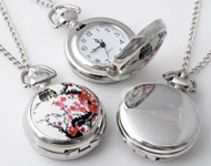 Metal necklace ± 77cm with clock/watch decorated with ceramic with blossom ± 43x29mm