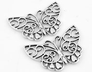 Metal pendant/connector butterfly decorated ± 39x26mm