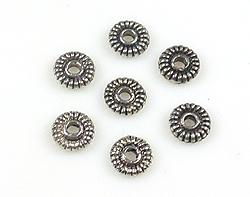 www.beadyourfashion.nl - Metalen kralen rondel bewerkt ± 5mm, ± 1mm dik (gat ± 1,5mm)