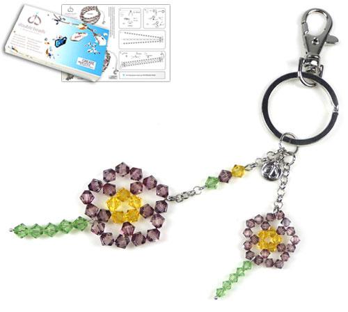 www.beadyourfashion.nl - DoubleBeads Sieradenpakket Flower Power sleutelhanger ± 19cm met SWAROVSKI ELEMENTS kralen en diverse materialen (o.a. metalen accessoires)
