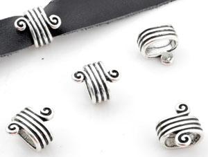 www.beadyourfashion.nl - Metalen schuifkraal bewerkt met spiraal ± 16x14x10mm (gat ± 11x7mm)