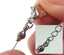 Finishing a necklace made of steel wire using a pinch cap